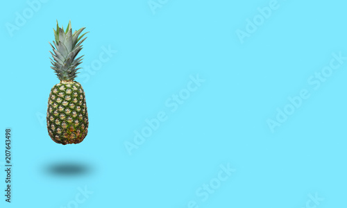 Pineapple on blue background. Minimal style with copy space - 207643498