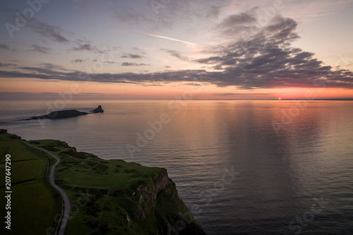 Canvas Zalm Aerial view of sunset at Rhossili Bay - Rhossili Bay has been voted Wales' Best Beach many times. It is located on the west coast of Gower Peninsular