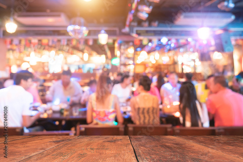 abstract blur image of night festival in a restaurant and The atmosphere is happy and relaxing with bokeh for background - 207649030