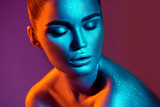 Fashion model woman in colorful bright sparkles and neon lights posing in studio, portrait of beautiful sexy girl. Art design colorful vivid makeup - 207649215