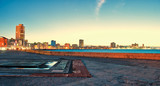 view of the malecon in the city of Havana at sunset in Cuba