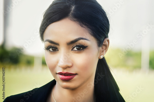 Beautiful elegant woman with long dark hair