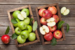 Green and red apples in wooden box - 207665077