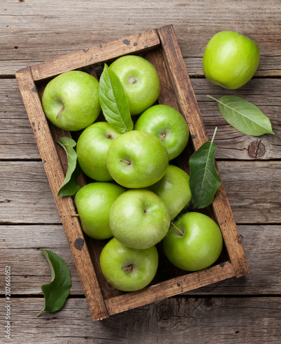Green apples in wooden box - 207665052