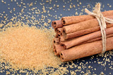 Cinnamon sticks with brown sugar on slate - 207674470