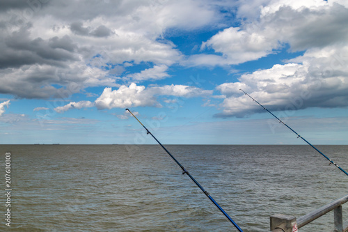 Fotobehang Blauw Fishing rods dangling off the pier at Southwold in Suffolk
