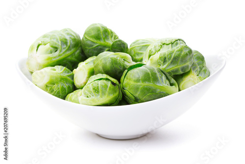 Fotobehang Brussel heap of brussels sprouts in bowl isolated on white background