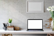 Mock Up workspace, Blank screen laptop and mockup poster on desk. - 207696867