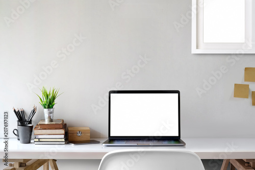 Mock Up workspace, Blank screen laptop and mockup poster at workplace. - 207697023