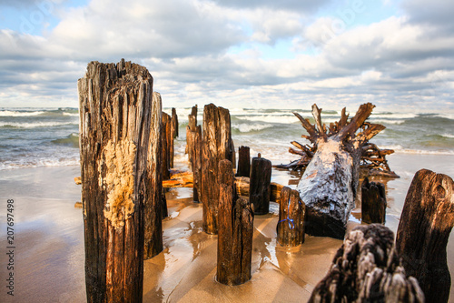 Fotobehang Pier Worn and weathered Lake Michigan wooden piers in the sunlight
