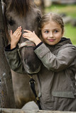 Young horse riding girl, equestrian sport . Horseback girl on field. - 207707045