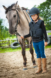 Young horse riding girl, equestrian sport . Horseback girl on field. - 207707231