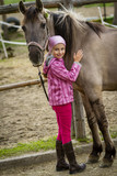Young horse riding girl, equestrian sport . Horseback girl on field. - 207707406