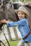 Young horse riding girl, equestrian sport . Horseback girl on field. - 207707436
