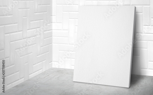 Blank poster at corner studio room with white tile wall and concrete floor background,Mock up studio room for display or montage of product for advertising on media,Business presentation. © weedezign