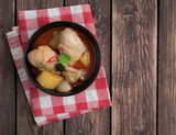 Spicy Muslim chicken curry,Thai massaman curry in a bowl on wood background,top view - 207714294