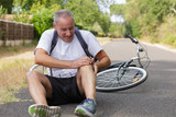 man having injuries after a fall on the bike - 207715673