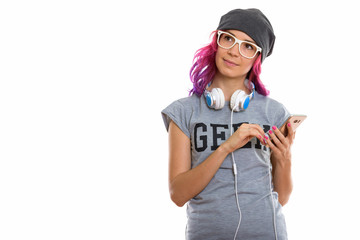 Studio shot of geek girl holding mobile phone while thinking wit