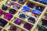 Online sunglass shop and different apparel for eyes with colorful accessories and trendy lenses. - 207721498