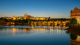 Panorama view of Saint Vitus Cathedral with Prague city skyline at night in Prague, Czech Republic - 207722696