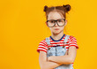 Leinwanddruck Bild - funny child girl in glasses on colored background