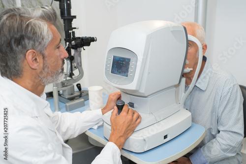 Leinwanddruck Bild Senior man having eye test