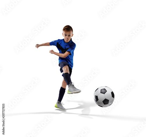 Fotobehang Voetbal football player kid kicking the ball