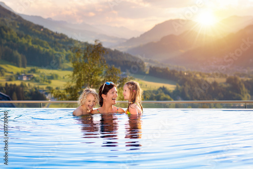 Family in swimming pool with mountain view - 207730045