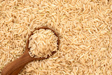 Brown rice in wooden spoon on rice seed background - 207733261