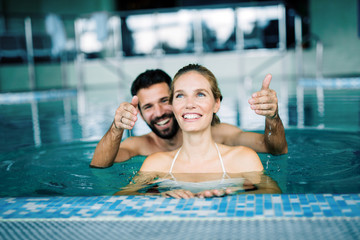Happy attractive couple relaxing in swimming pool © nd3000