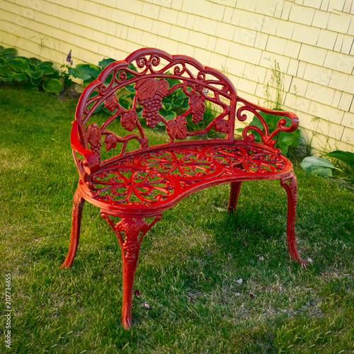 Ornate Red Wrought Iron Garden Bench.