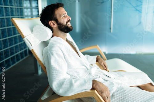 Foto Murales Portrait of handsome man relaxing in spa center