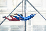 Skydivers in indoor wind tunnel, free fall simulator - 207742679