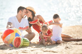 Cheerful family on the beach. Family on vacation - 207744298
