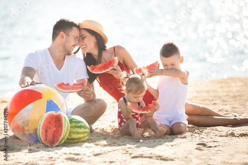 fototapeta na ścianę Cheerful family on the beach. Family on vacation