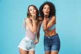Two pretty young girls dressed in summer clothes - 207749436
