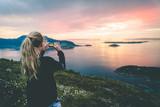 Tourist take a photo of beautful nordic landscape. - 207759610
