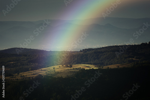 Plexiglas Zwart rainbow landscape, summer evening with rainbow over hills