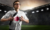 Japan soccer or football supporter showing flag under his business shirt on stadium.