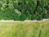 aerial view of forest road and meadow from the drone