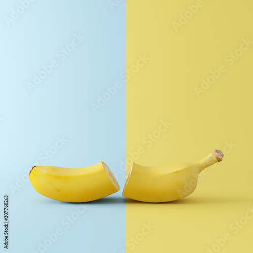 Banana sliced on blue and yellow background. minimal concept © aanbetta