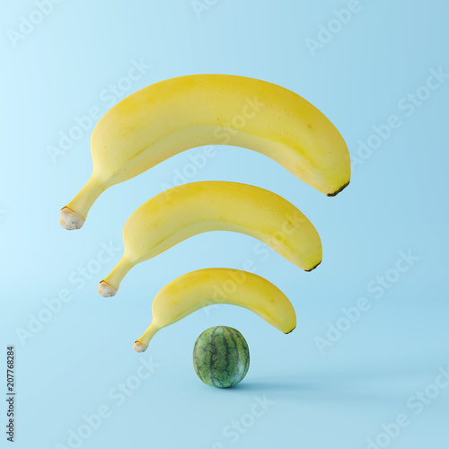 Banana wifi with watermelon on pastel blue background. Creative idea. minimal concept © aanbetta