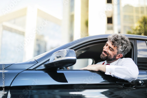 Businessman traveling by car