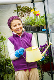 Beaitful child playing in greenhouse and care for plants. Cute girl engaged in gardening in the backyard. Spring organic growth concept. - 207777603