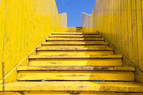 Fotobehang Rotterdam Yellow stairs of the wooden Luchtsingel bridge, Rotterdam, Netherlands with blue sky in summer