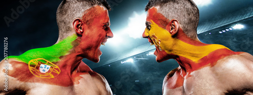 Aluminium Voetbal Portugal vs Spain. Two soccer or football fans with flags face to face on stadium.