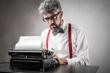 Leinwanddruck Bild - Man using a typewriter