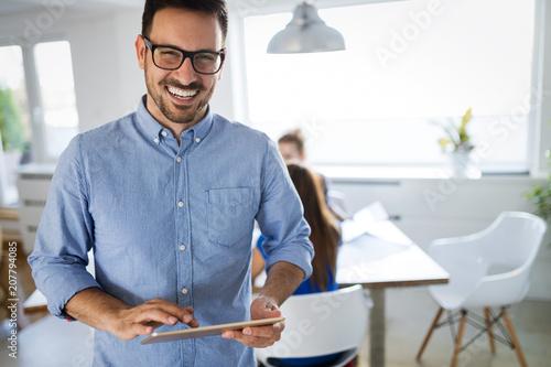 Leinwanddruck Bild Portrait of handsome male company trainee in office