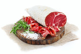 Sliced cured coppa with a sprig of rosemary. - 207797088