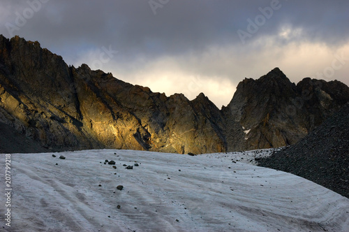 Fotobehang Grijze traf. Arbuz glacier with surrounding rocks at sunset. Altai mountains, Russia